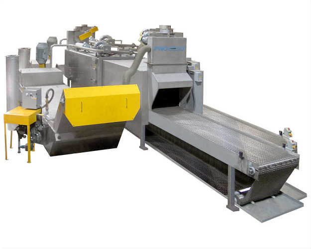 Heavy-duty conveyor parts washer designed for automatic cleaning of heavily contaminated components