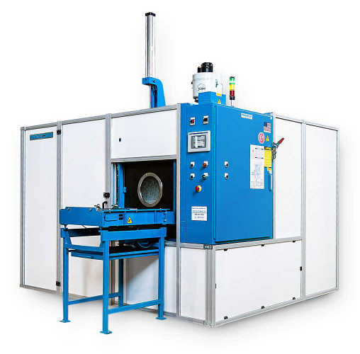 Spray and immersion washer that cleans and vacuum dries complex workpieces in a single footprint.